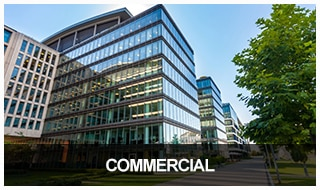 Image of a large, glass commercial office building