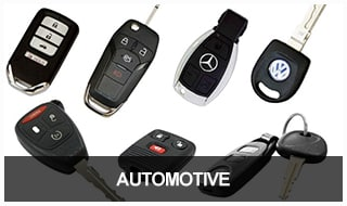 Image of a selection of car key fobs, transponder keys, and remotes