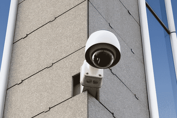 Image of a CCTV camera mounted on an outside wall of a commercial property