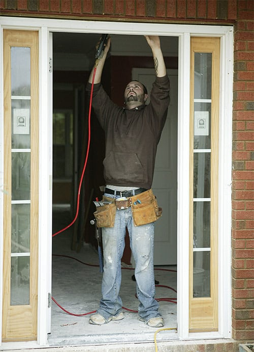 image of a locksmith installing a new door frame.