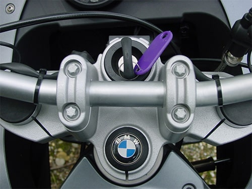 image of a BMW motorcycle ignition lock with key inserted
