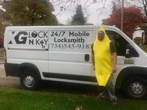 Image of the owner of XG Lock N Key in a banana costume in front of his locksmith van